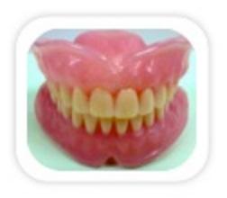 Prótese Total: São aparelhos removíveis em resina com dentes artificiais indicados para casos de ausências totais de dentes.